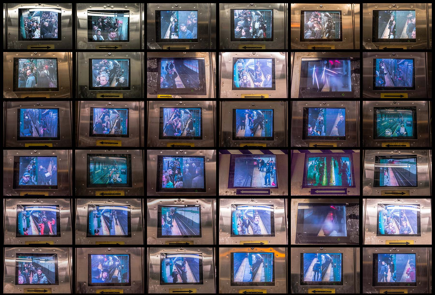 "Video monitors, large grid, from ""Sub/Culture."""