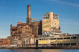 Refinery from River. Sweet Ruin: Relics and Stories of the Domino Sugar Refinery. Industrial ruin photograph by Paul Raphaelson.